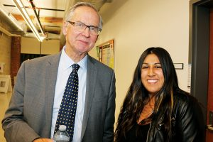 Ian Binne with second-year law student Aylina Dhanji get together at the reception following the speech.