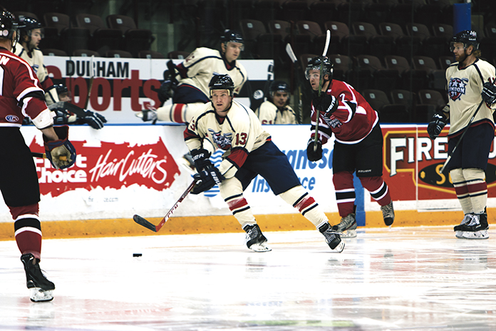 Jason Skinner, of the London 3's, takes part in the fast-paced action of 3-on-3 hockey in the newly formed 3HL