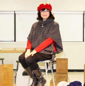 Lynn Dooly-Marek posing in the Figure Drawing classroom at Durham College