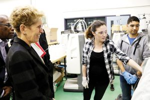 Candace Lavellee, a bio-medical engineering technologist at DC demonstrates her work to Premier Kathleen Wynne during her visit to the college.
