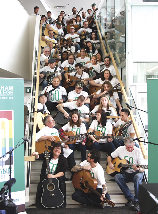 50 guitarists gathered on the SSB staircase, where they strummed through two songs in unison.