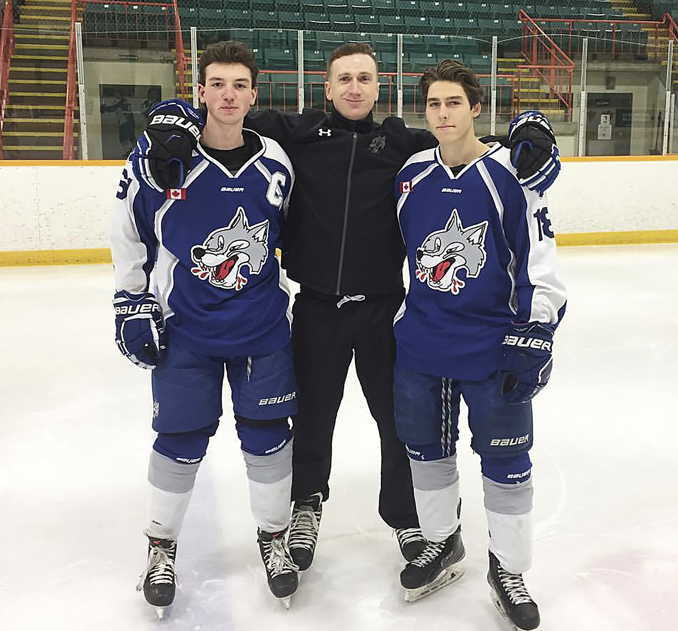 Photograph from McGillis' Instagram Brock McGillis (middle) works with players like Jake Burton (left) and Alex Rodrigue of the Sudbury Wolves, McGillis' former OHL team.
