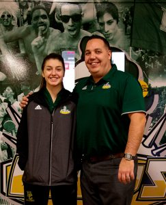 Photo by Austin Andru Cassidy Nicholson-Clarke (left) with her coach Tony Clarke (right)