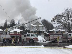 Photo by Kaatje Henrick Fire officals battle the flames of a house fire on Feb.9.