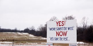"A sign reading ""Yes, we saved the west, now let's save the rest"" protesting the building of the Pickering Airport."