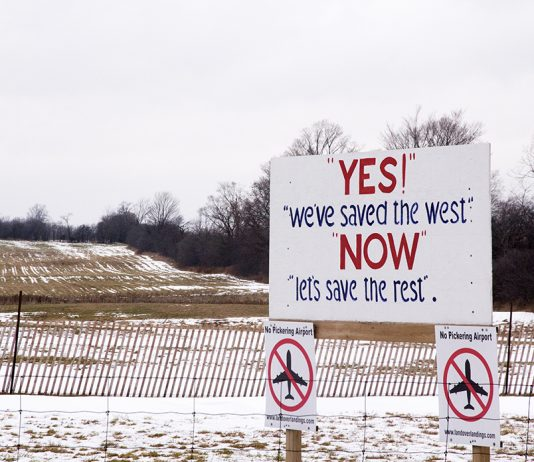 """A sign reading """"Yes, we saved the west, now let's save the rest"""" protesting the building of the Pickering Airport."""
