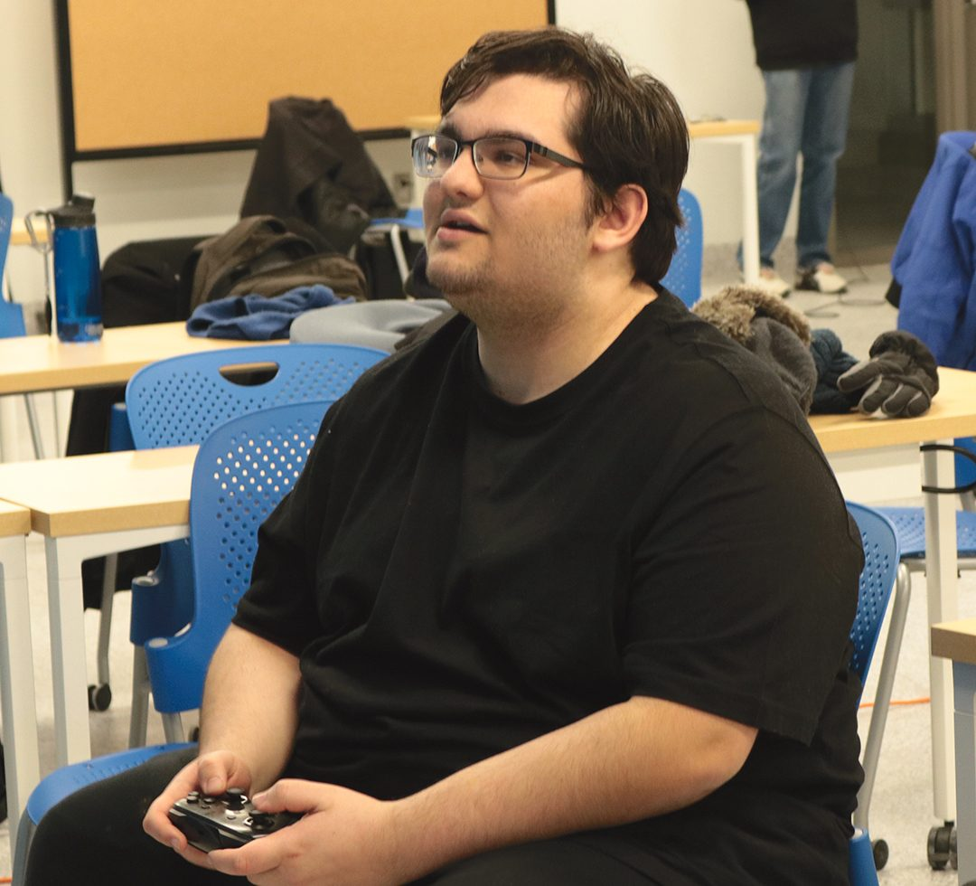Anime on Campus club member, Michael Milivojevich playing Super Smash Bros. Ultimate.
