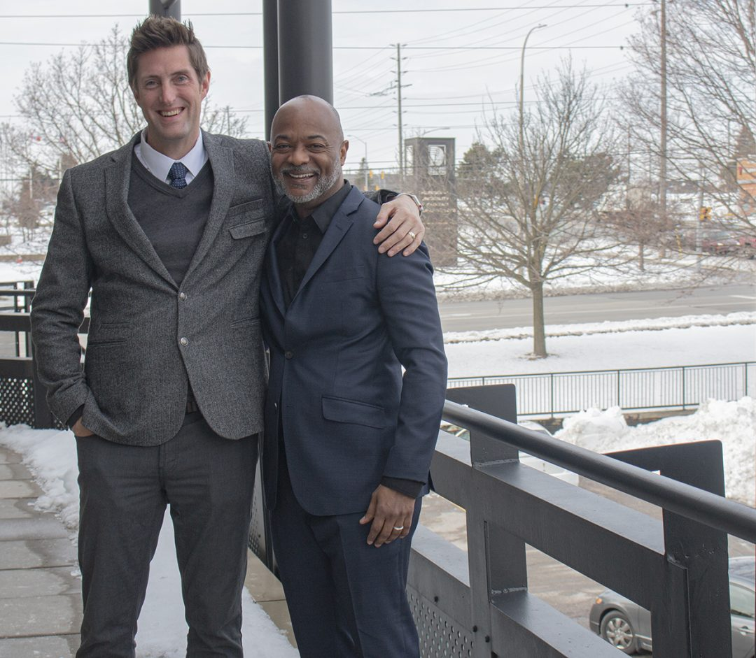 Whitby MP Ryan Turnbull (left) and Roger Dundas at Turnbull's head office. Turnbull officially congratulates Dundas on receiving the Heritage Award, a federal government grant. Dundas is the co-founder of ByBlacks.com, an online magazine.