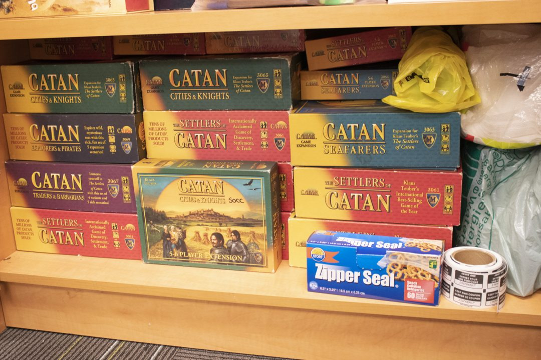 The Ontario Tech Board Game Club has many copies of Settlers of Catan with lots more expansions, variants and add-ons.