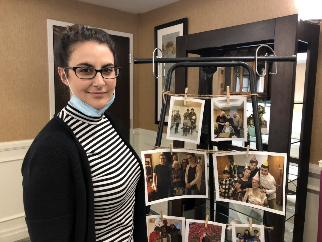 Emily Keevill, 27, showcases her work on the Mother's Day honour wall at the retirement residence.