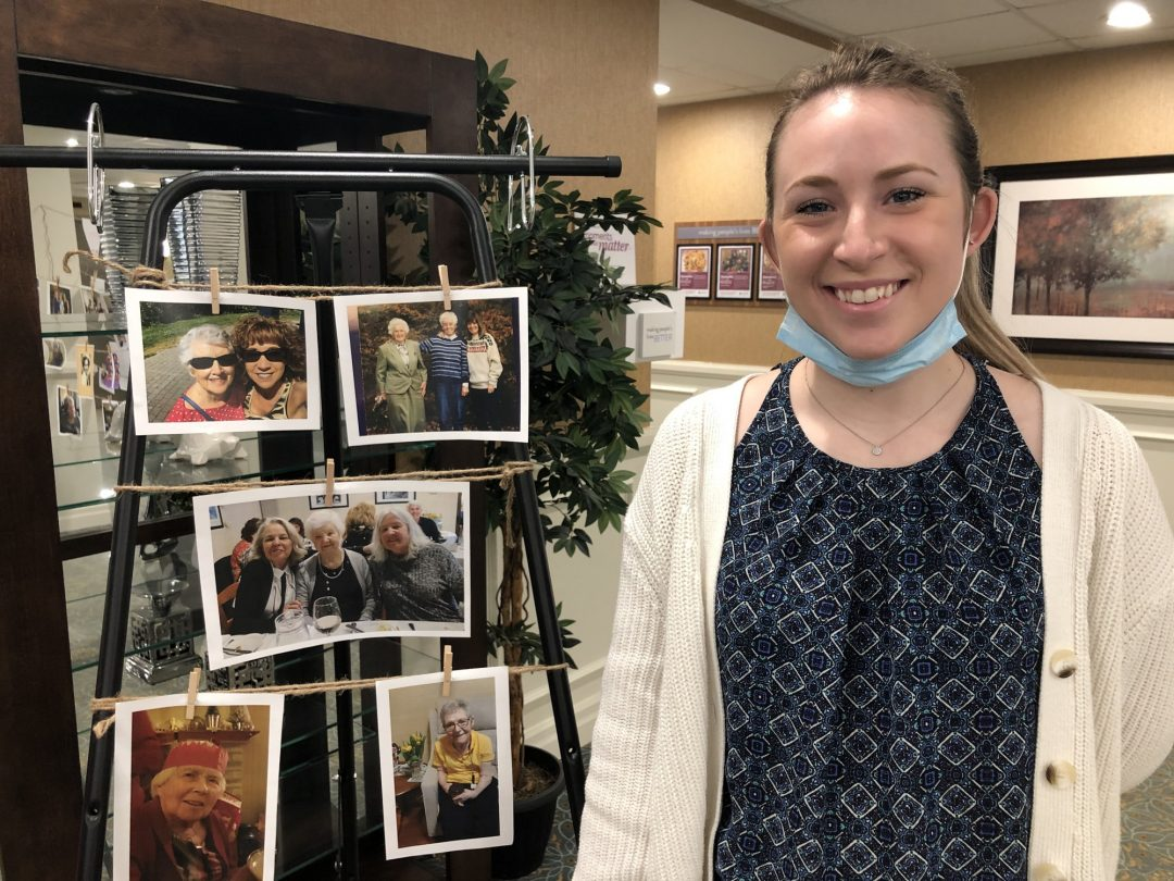 Tori Van Staveren , 23, showcases the wall created in honour of all Mother's at the retirement residence.