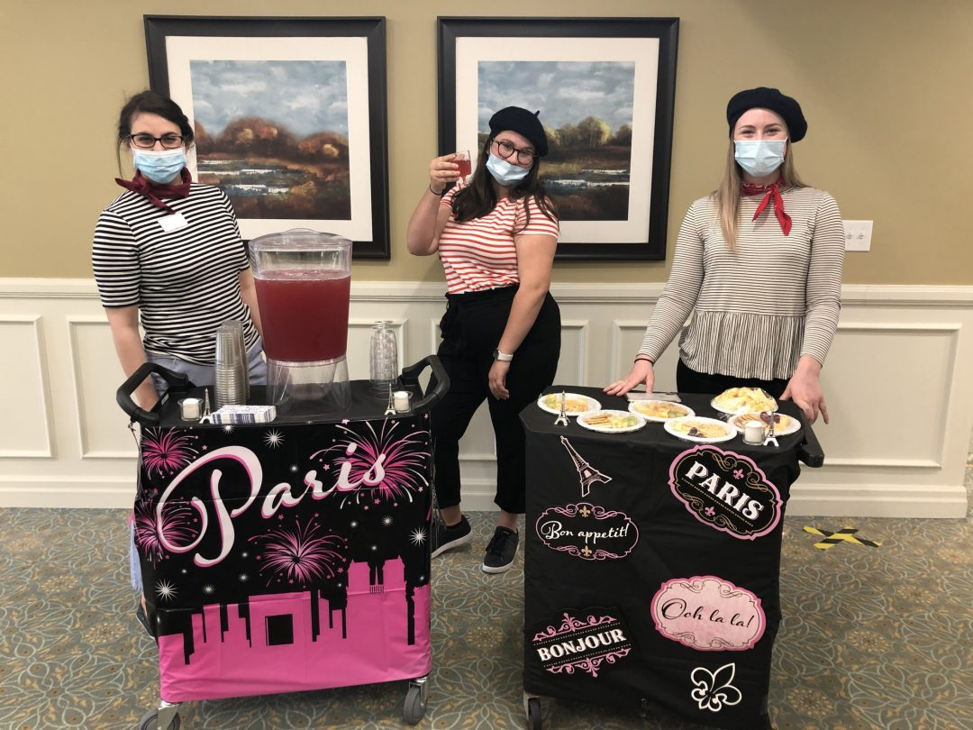 Activity workers travel door to door to deliver beverages and snacks to residents with their French themed bar cart. (From left to right), Emily Keevil, Janneke Van Staveren, Tori Van Staveren.