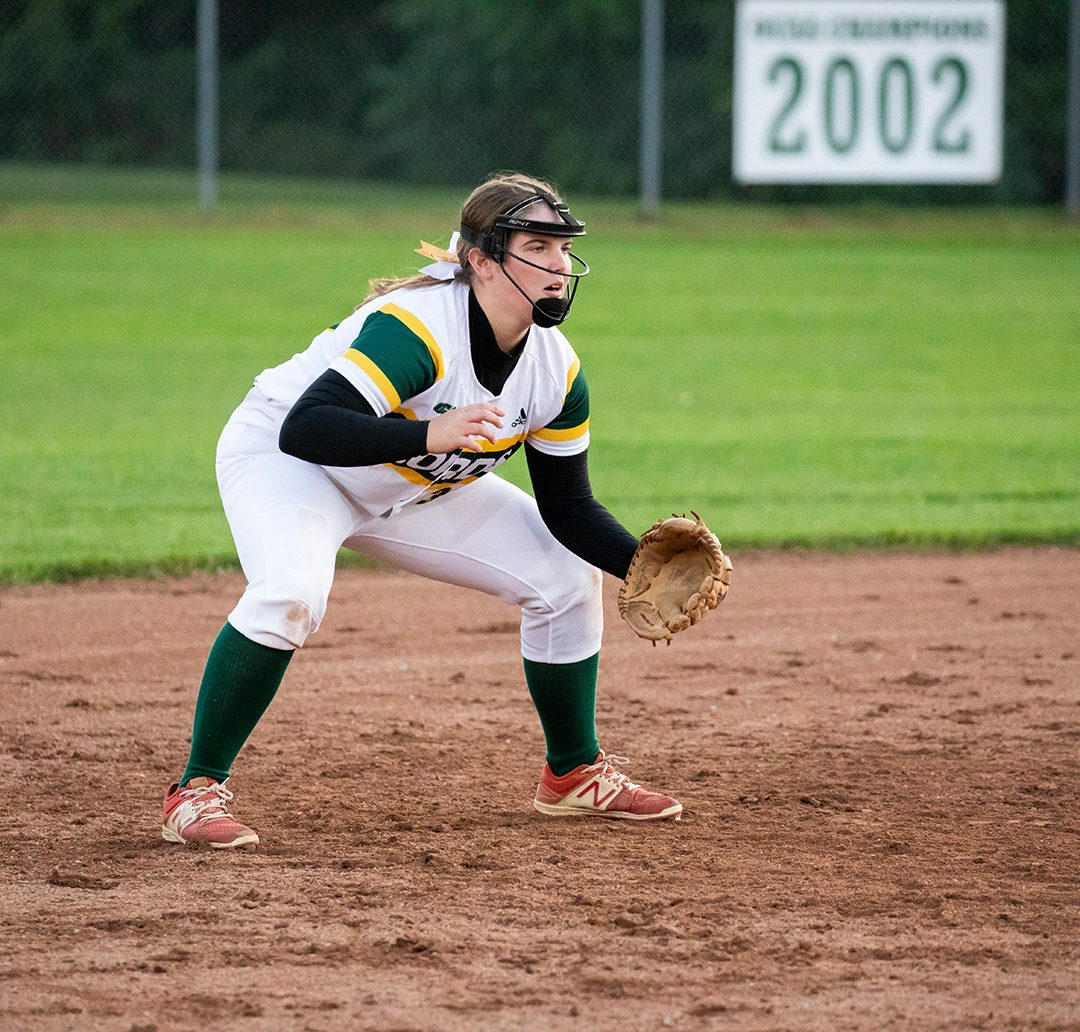 Courtney McKellar gets ready to make a play during a softball game.
