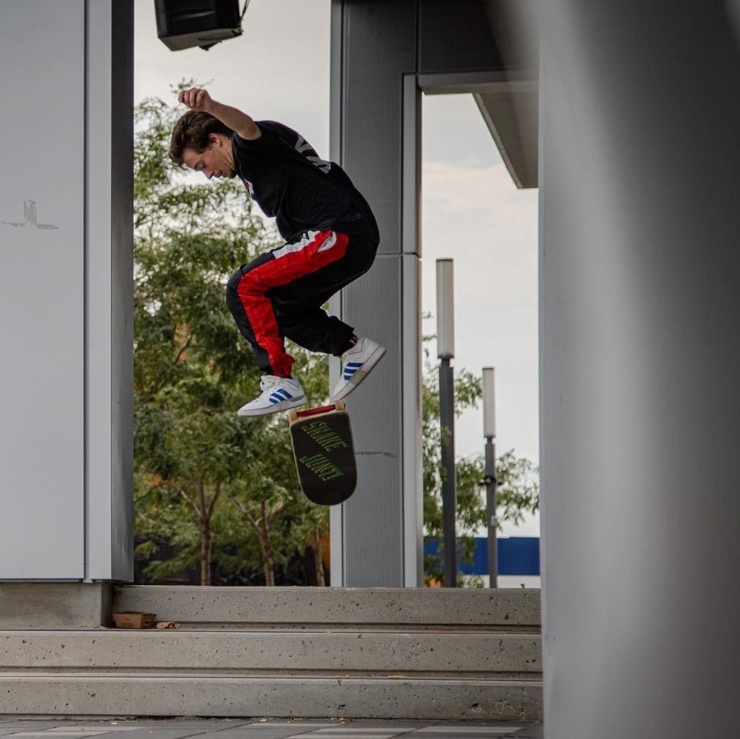 Kris Hanson, founder and owner of the Progression Skateboard Co. does a skateboard trick at a outdoor skatepark.