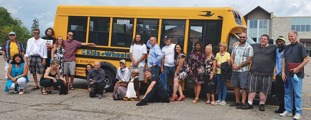 Angie Papas (pictured extreme left, bottom) along with a group of unsheltered individuals from Camp Samac, after attending Sunday service at Christian Faith Outreach Center in Ajax.