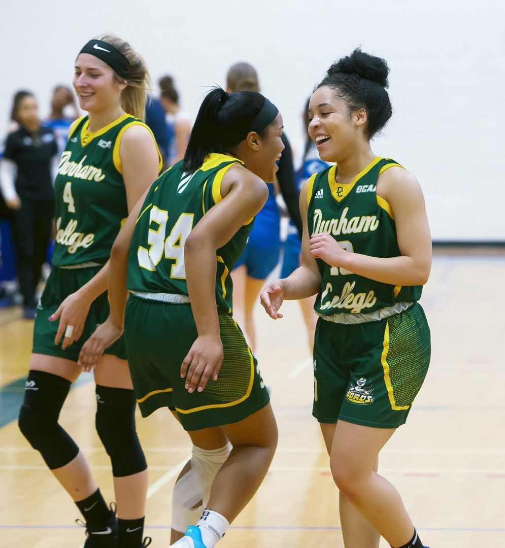 OSHAWA ONT. Kendra Oliver, 19, and her sister Sierra Oliver, 20, laughing with each other after they beat the woman's basketball team at George Brown.