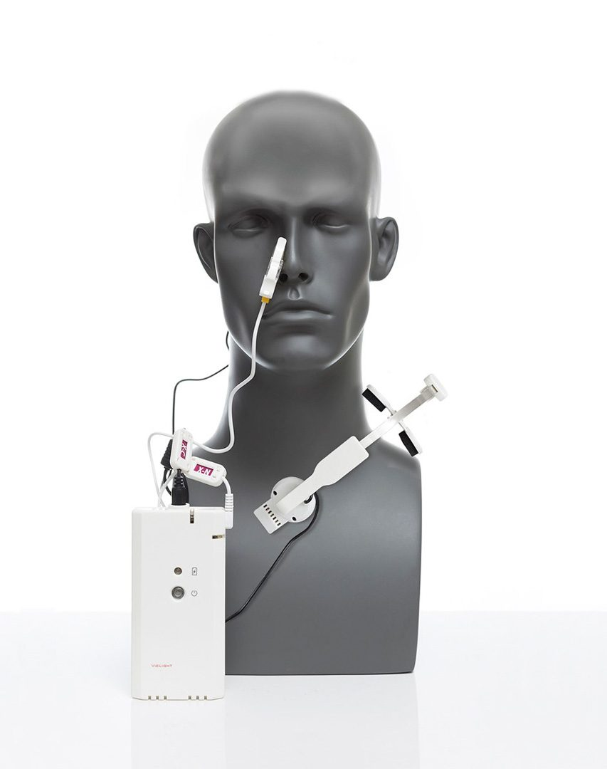It shows how the device is correctly placed on a person. Red light is from the nose and the near infared light from the chest.