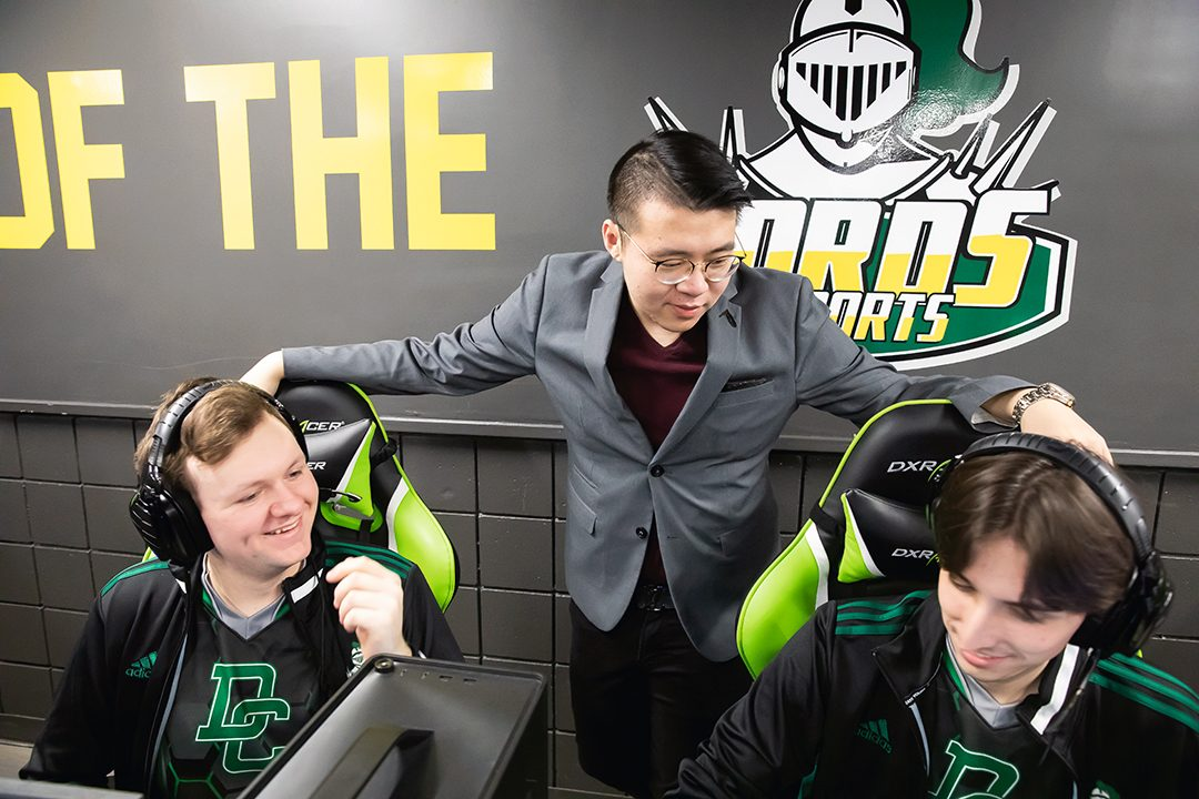 Bil Ai, General Manager of Esports at Durham College with Esports student athletes.