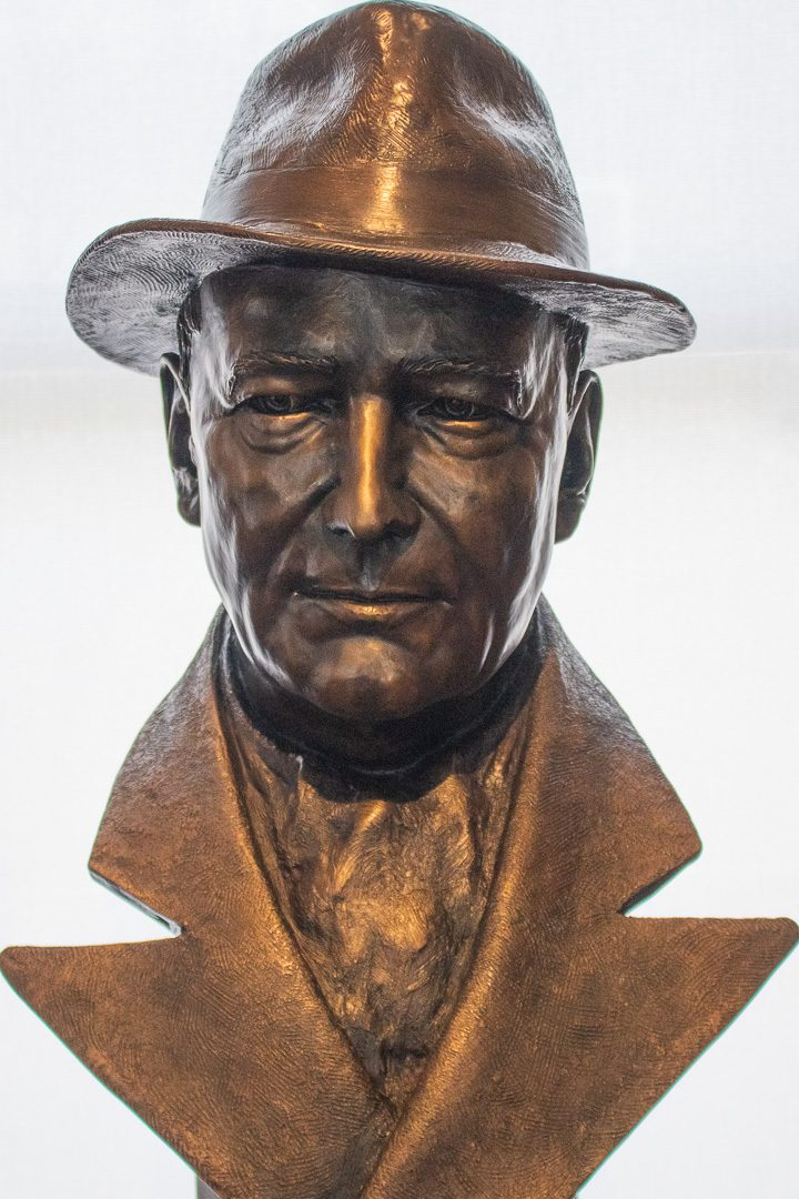 Station gallery Whitby, spying on the posters of James Bond is bust of Sir William Stephenson, a real Canadian spy. This single piece by Ruth Abernethy was loaned to the gallery for this event. Abernethy a renowned Canadian Sculpture.