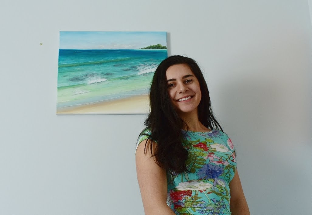 Katherine Polack poses with her ocean-inspired art.