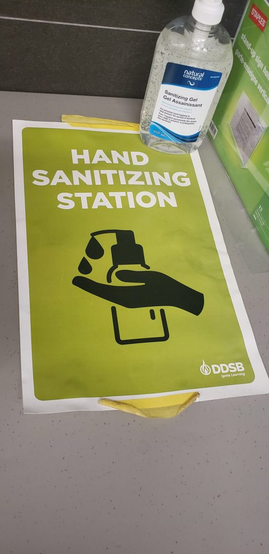 A sign showing people where a hand-sanitizing